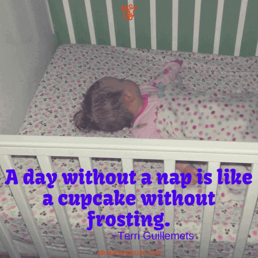 A day without a nap is like a cupcake without frosting. ~Terri Guillemets (purple text over baby sleeping in a white crib).