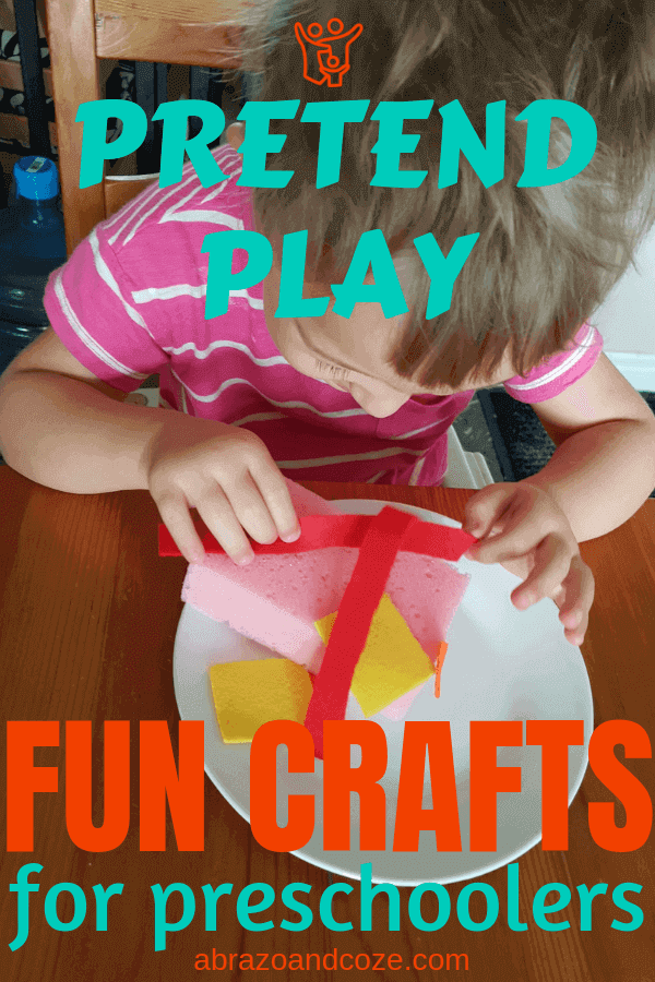 Pretend Play (block cap letters in teal centered at top) Fun Crafts (orange block letters) for preschoolers (teal text), all over a photo of a preschooler decorating a pretend play cake, made of pink sponge, with various felt shapes.
