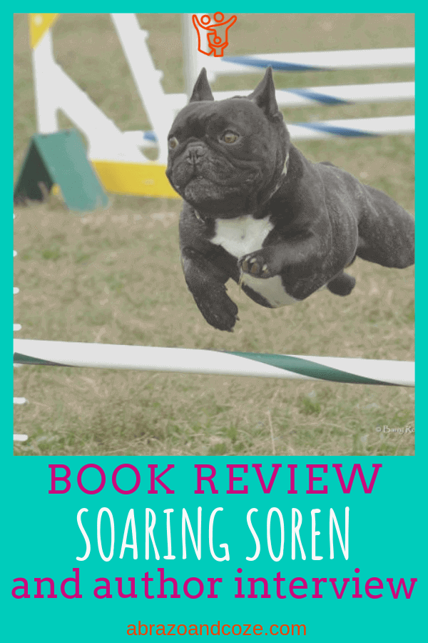 Soren soaring over an agility bar, Book Review of Soaring Soren and author interview of Deborah Stevenson