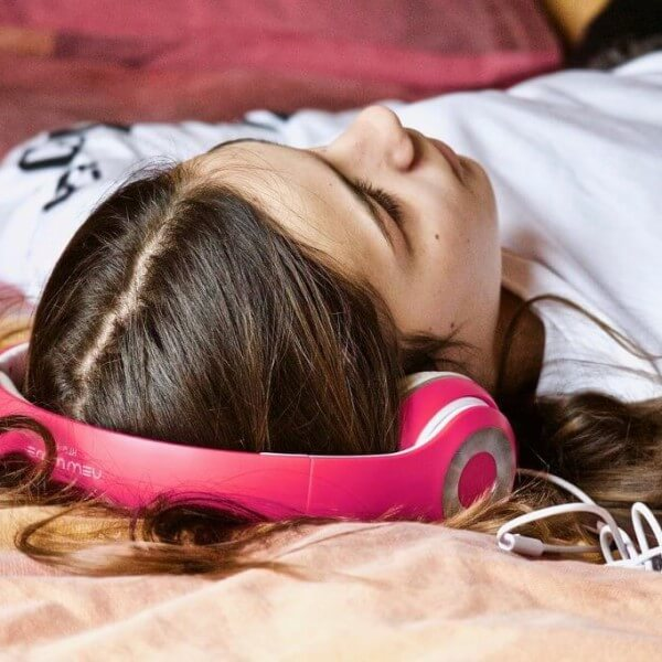 Get your headset on like the woman in this pic, and listen to your favourite tunes, or, tune in to some binaural beats. Read the article for the many other natural stress relievers.