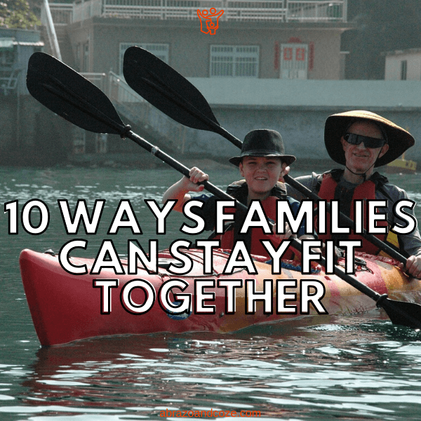 Father and child kayak together, happily, on still water, staying fit together. 10 Ways Families Can Stay Fit Together